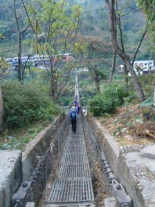 Suspension bridges have been donated by many countries to assist the crossing of the many rivers and deep gorges in Nepal