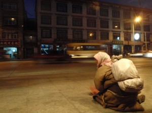 A beggar woman on the Lhasa street outside the restaurant.