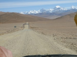 Mountains in the distance... a better stretch of road (just for the moment)