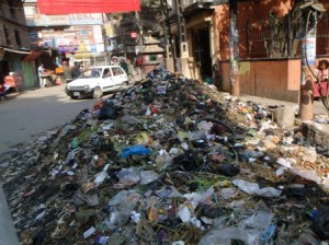 Whilst in Tibet, the garbage collectors have been on strike - not the view of Greater Thamel one sees in the Lonely Planet