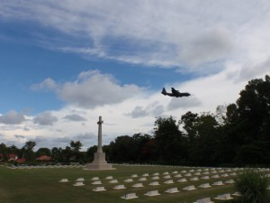 Strange combination of military plane, war memorial and cemetary