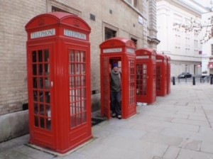 Scott in the traditional London phone boxes