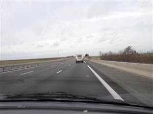 Vinnie and wind turbines on the road to Calais